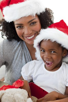 Mother and daughter having fun at Christmas time