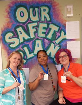 Beth Nave, Tabitha Byrd and Nicole Freccia show off their lanyards and safety plans.